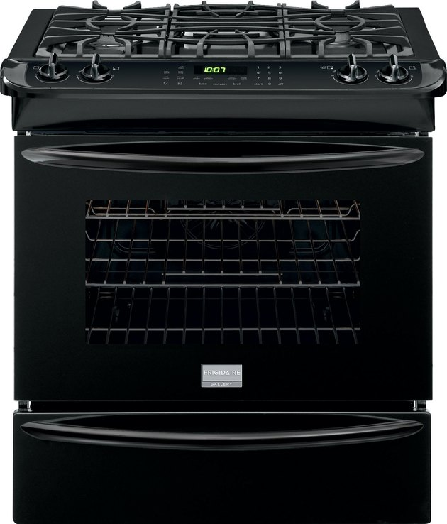 Black small gas stove with storage drawer and grates