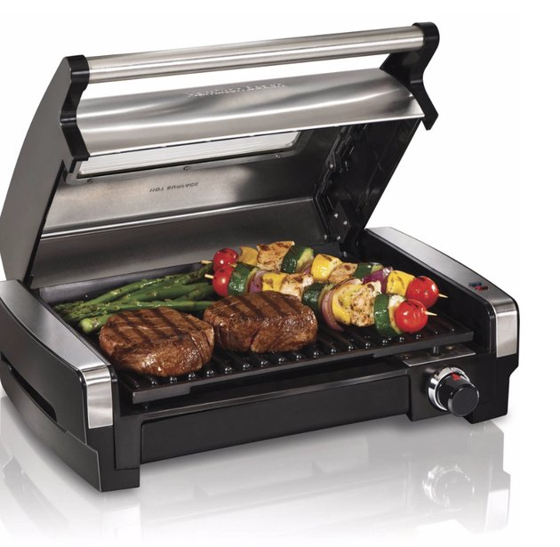 Electric grill with steaks, veggies. small stove size ideas