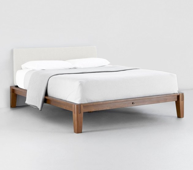 eco-friendly bed frame with upholstered headboard