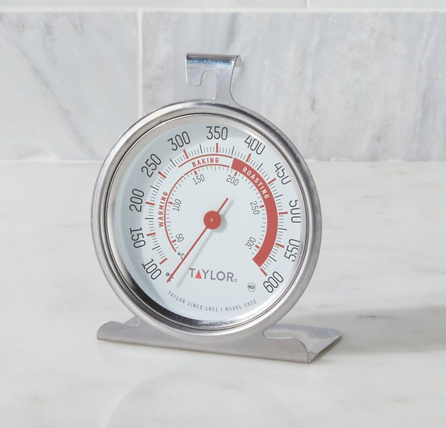 Oven thermometer on marble counter. small stove size ideas