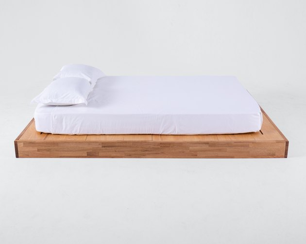 eco-friendly bed frame with bedding on top