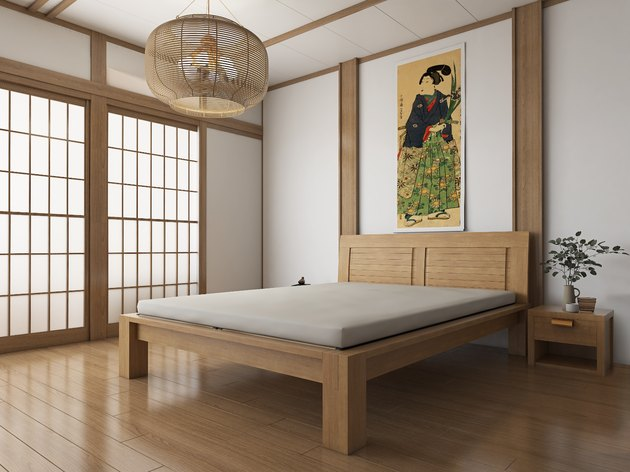 Japanese style room with eco-friendly bed frame in the center and art above it