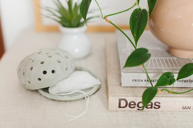 The mint green color of this organic-shaped diffuser gives it style and sophistication.