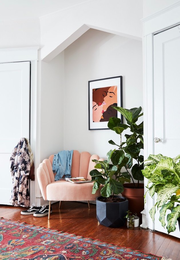 sitting area with blush lounge chair and potted plants
