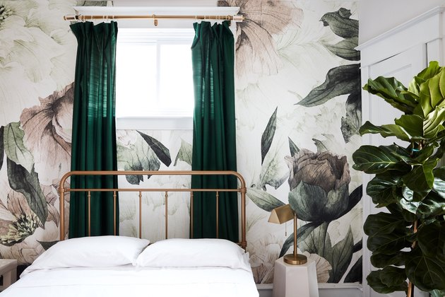 bedroom with floral wallpaper and green drapery