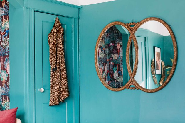 green walls with framed mirror