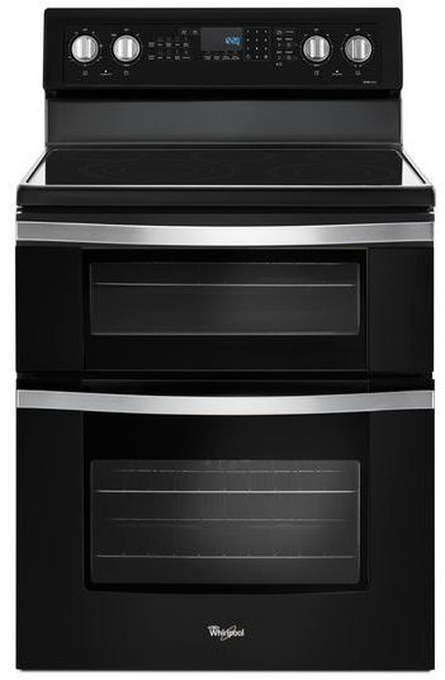 black stainless steel flat top electric stove with two ovens