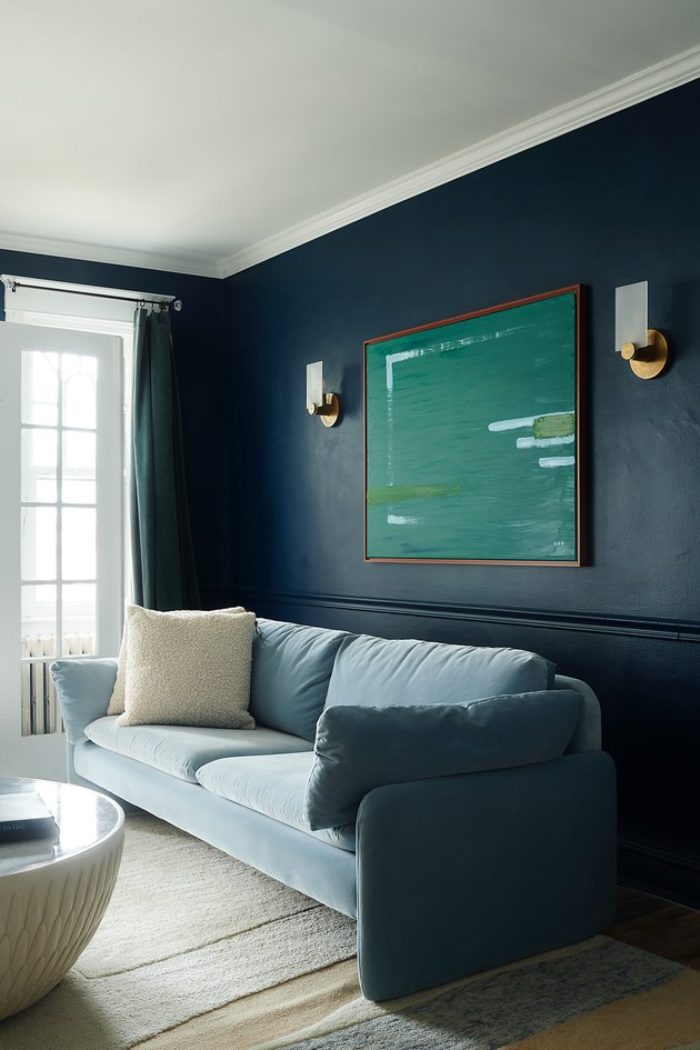 living room with blue walls and light blue sofa