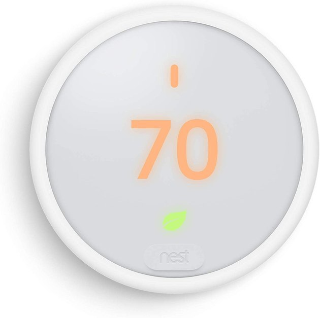 White circular thermostat with touchscreen