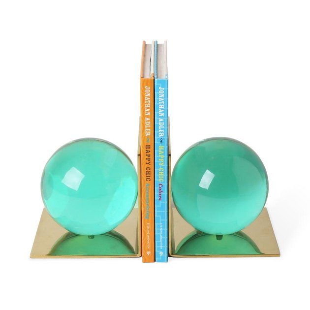Aquamarine globe bookends with brass backs