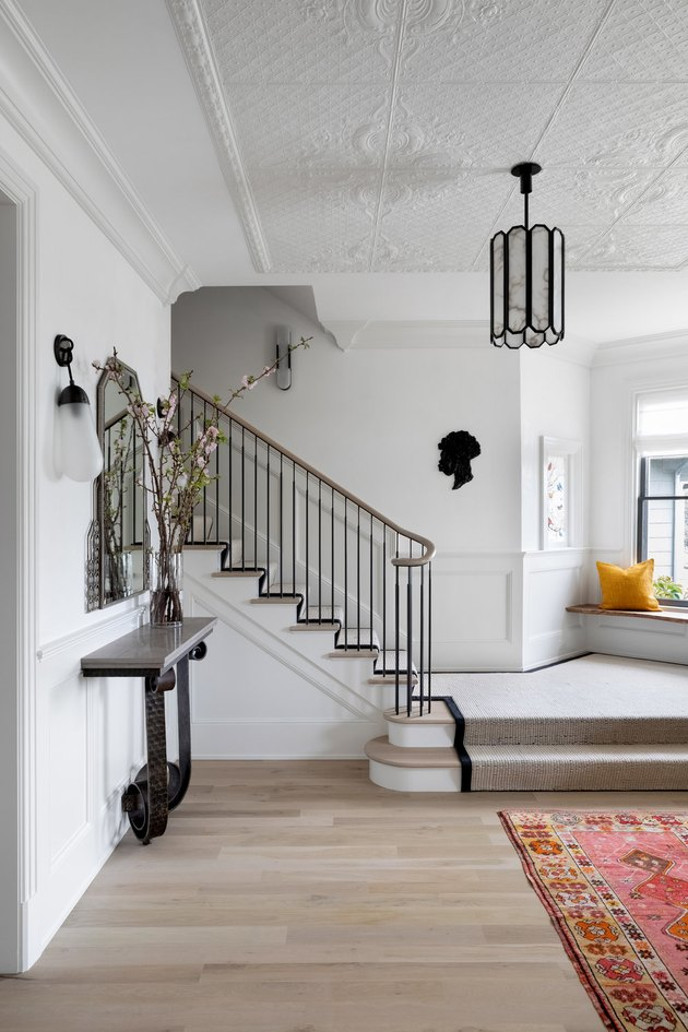 Black Contemporary Foyer Lighting in entryway designed by Chango & Co