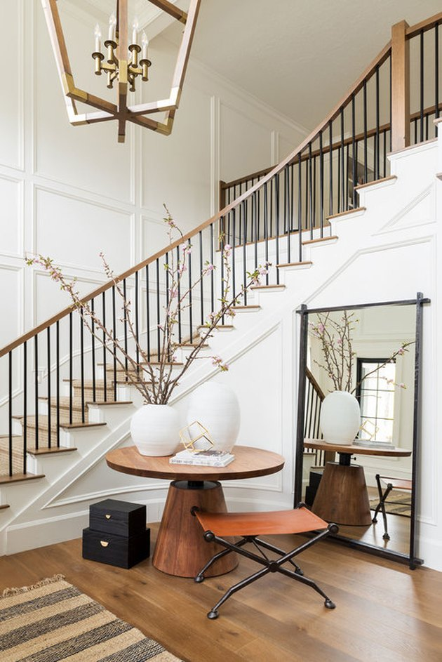 White, wood and gold entryway designed by Studio McGee with Contemporary Foyer Lighting