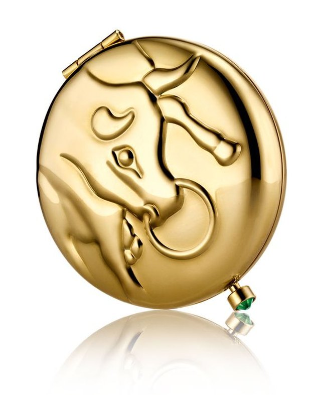 Gold compact with Taurus bull