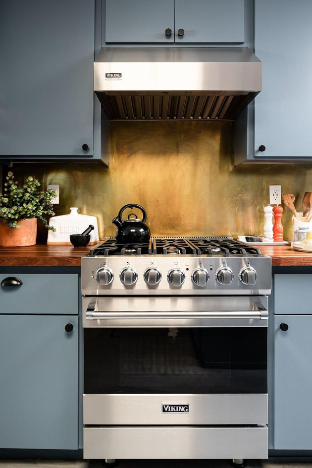 blue kitchen with contemporary gas new stove