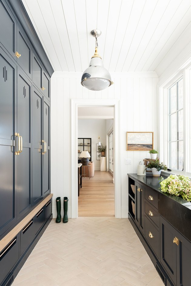 mudroom storage with moody black cabinets