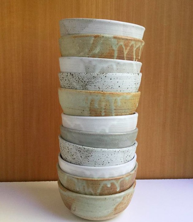 Stacked ceramic bowls of various colors