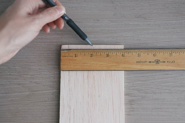 Marking middle of balsa wood with pencil