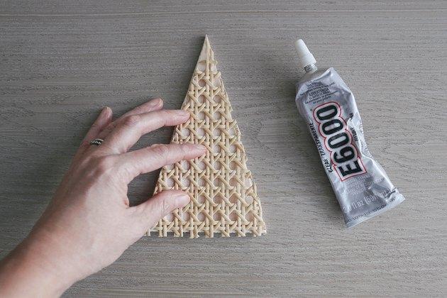Gluing cane webbing triangle to balsa wood triangle with E6000 glue