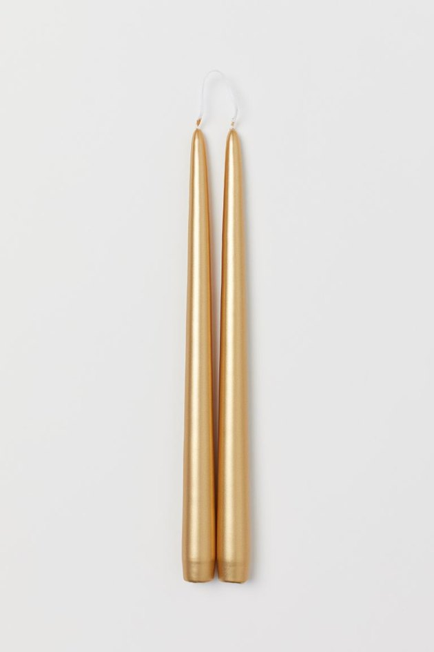 two gold tapered candles