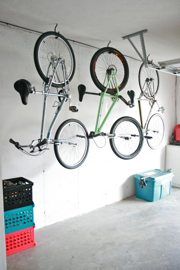 DIY garage organization idea with bikes hanging from garage ceiling