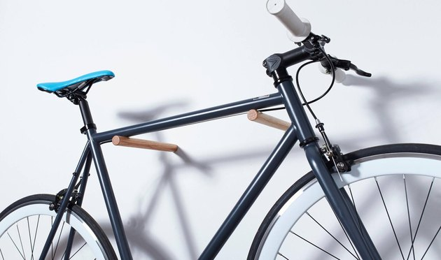 bike storage using wooden pegs mounted on the wall