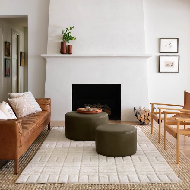 eco-friendly furniture with modern living room with green ottomans and white fireplace