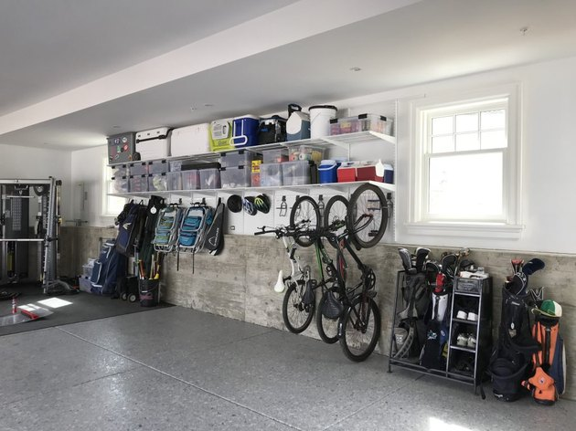 garage storage solution featuring Elfa utility rack for bike storage