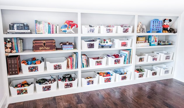 Toy storage on simple white shelves