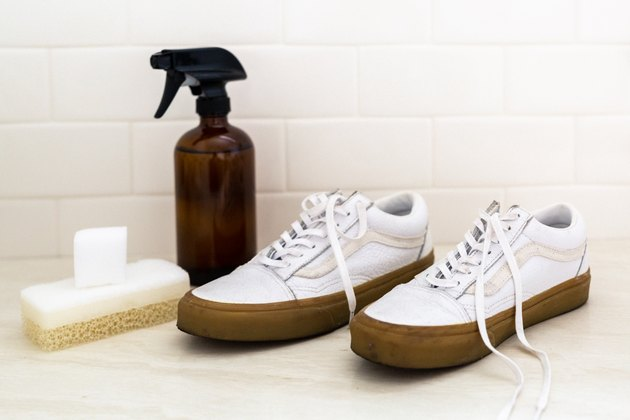 Shoes and cleaning spray bottle and sponge