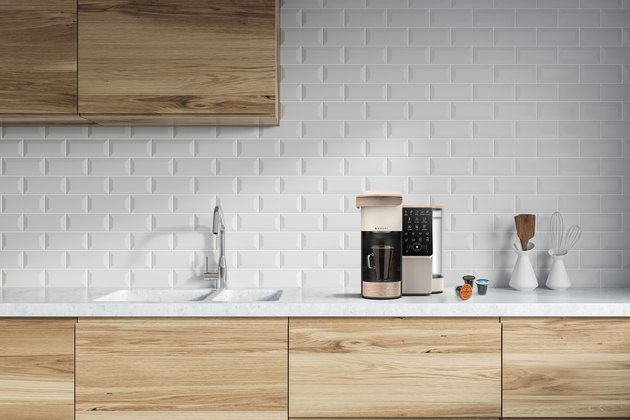 bruvi coffee system and B-Pods in kitchen with white brick backsplash and light wood cabinets