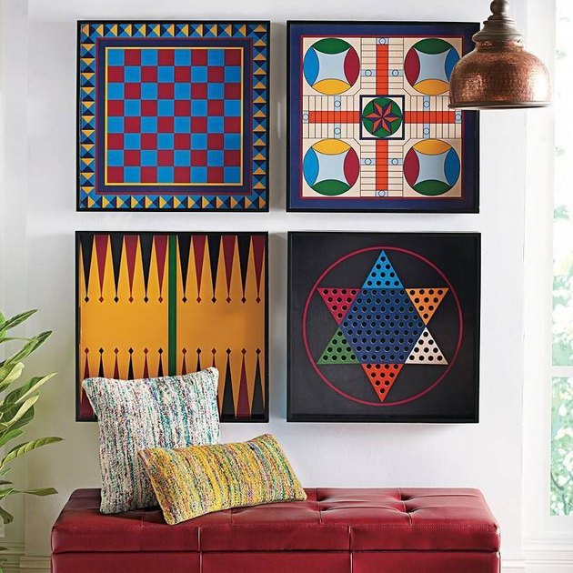 board game storage hanging on a wall over an ottoman