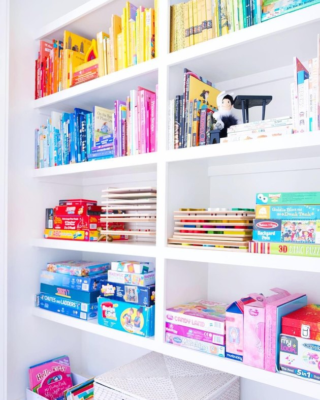 color coded bookcase with board game storage