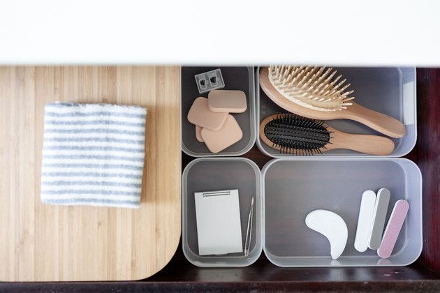 Toiletries in containers in drawer