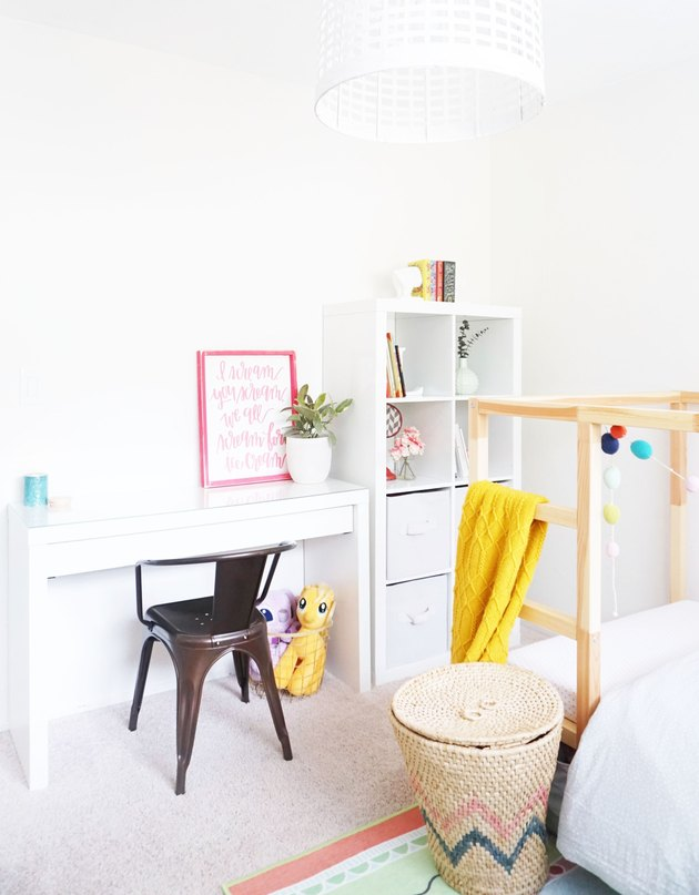 Kids' room organization with white walls, desk area, and bookshelf with cubbies