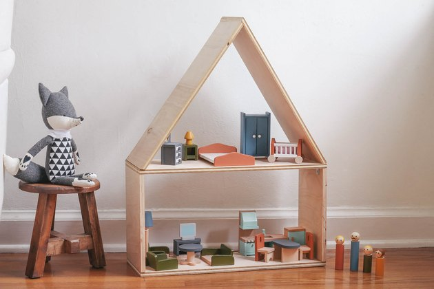 DIY wooden dollhouse with wooden dolls and colorful furniture