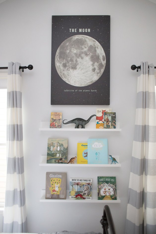 Kids' room organization  with floating bookshelves and moon poster