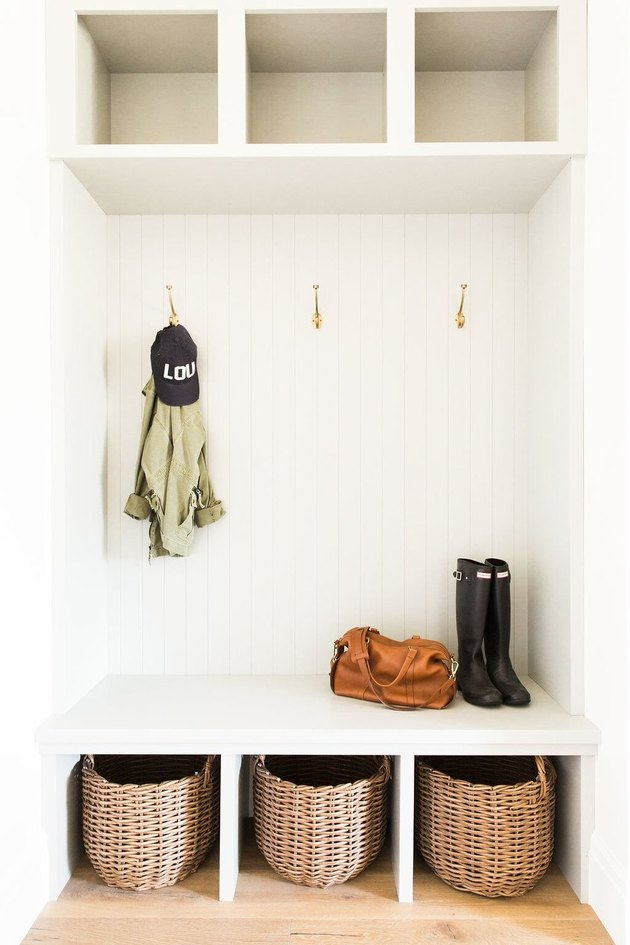mudroom storage unit with baskets underneath seats