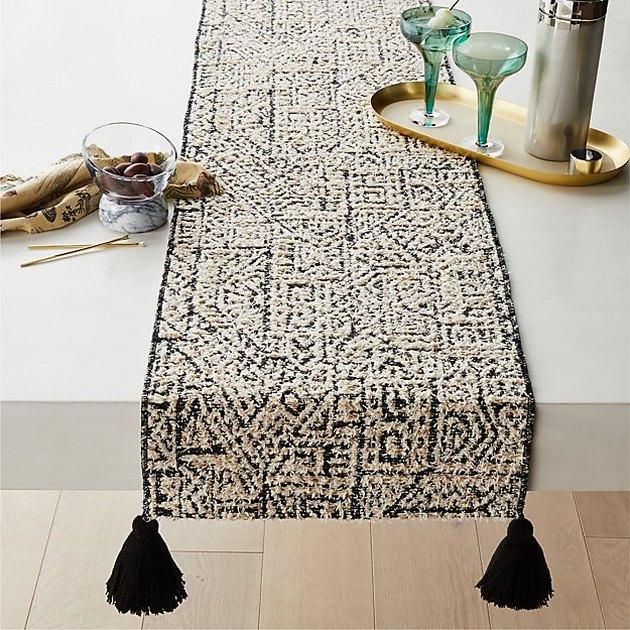 cream and black pattern table runner with tassels