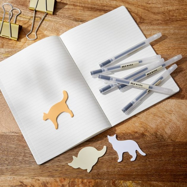 notebook with pens and cat-shaped sticky notes