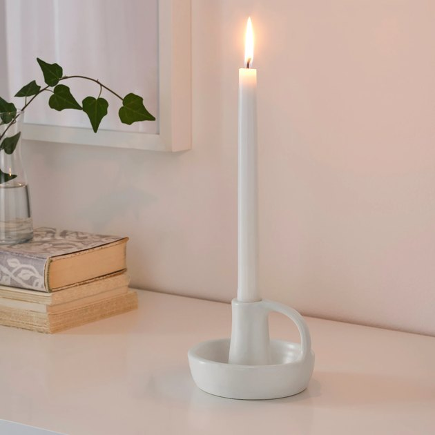 white candlestick on candle holder