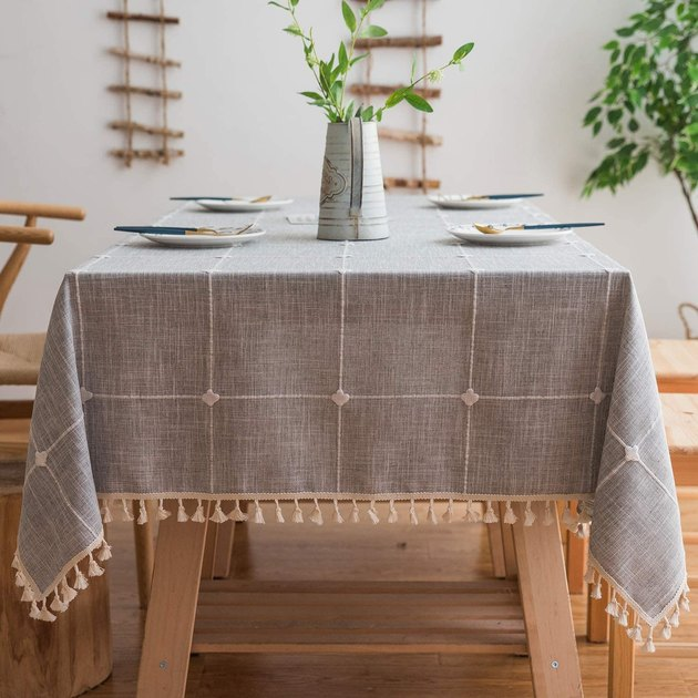 gray and cream grid tablecloth with tassels