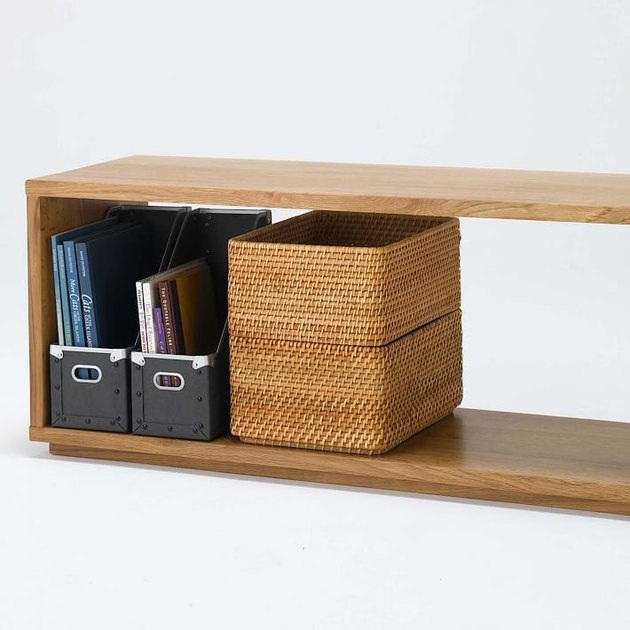 oak bench with magazine holders and baskets