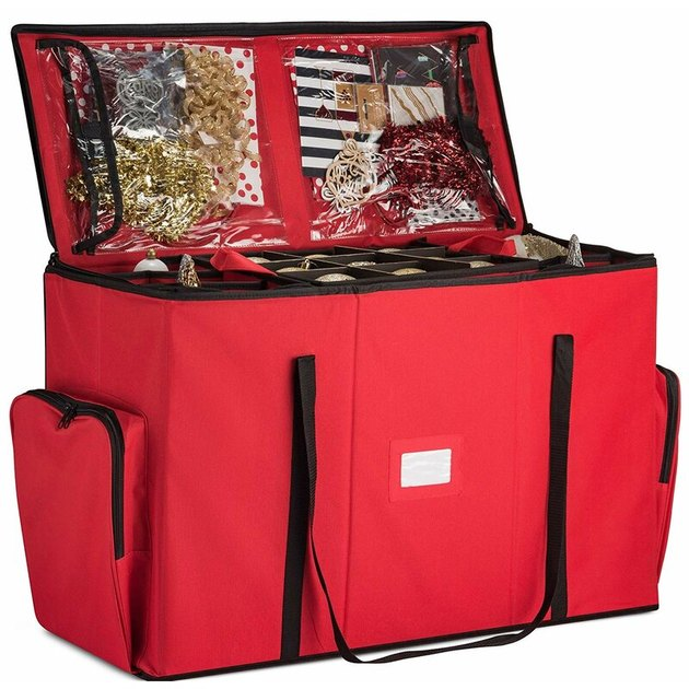 Red ornament storage bag with handles and clear plastic pockets