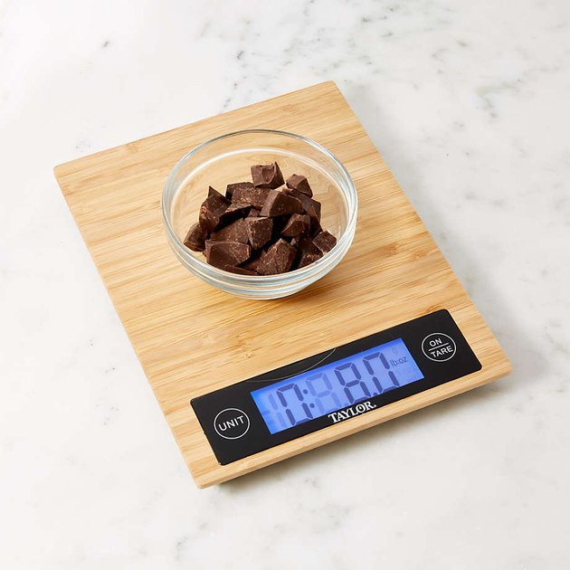 chocolate in bowl on bamboo kitchen scale