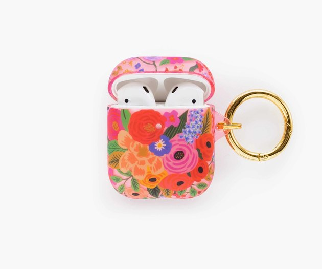 floral patterned airpods case with airpods inside