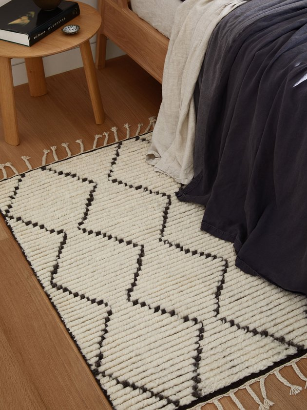 geometric rug next to bed