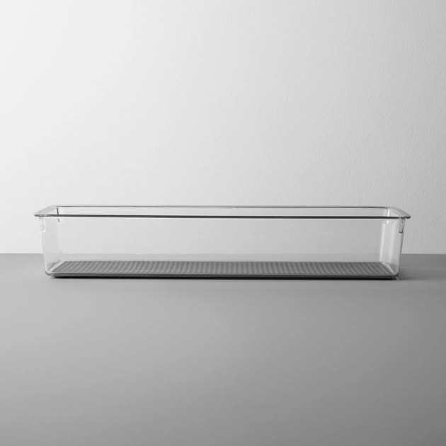 Clear acrylic utensil drawer organizer on gray background