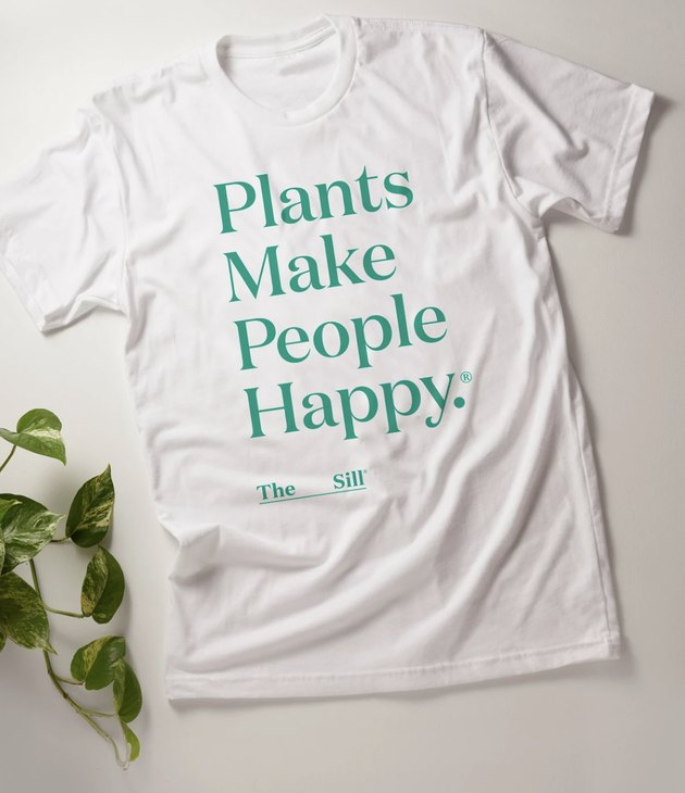 """white shirt with text that reads """"plants make people happy"""""""