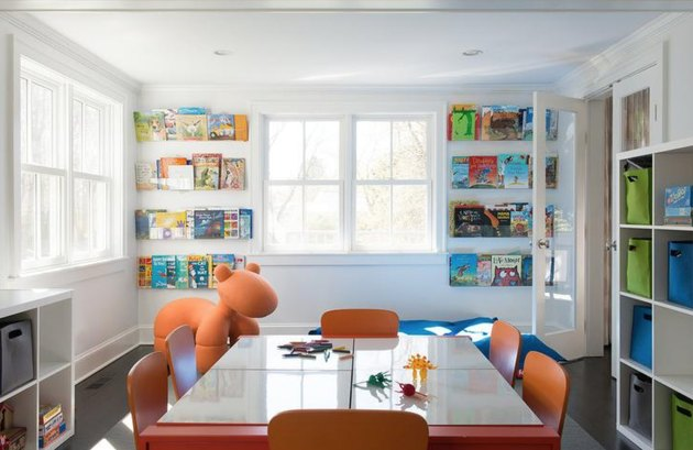 colorful playroom with acrylic kids' book storage idea