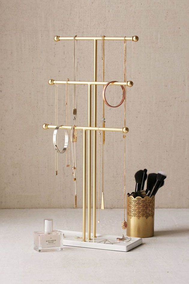 tiered jewelry organizer with hanging necklaces